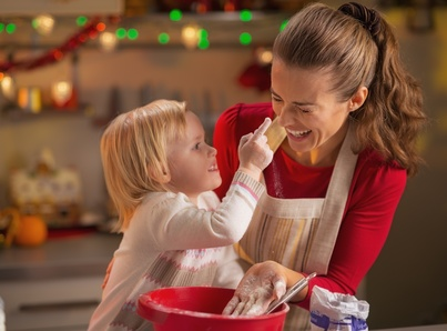 baby trying to smear mothers nose with flour while making christmas cookies - Making Christmas Cookies